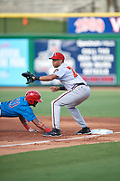 Florida Fire Frogs first baseman Kurt Hoekstra (20) stretches for a throw as Jose Pujols (23) dives back to the bag during a game against the Clearwater Threshers on June 1, 2018 at Spectrum Field in Clearwater, Florida.  Clearwater defeated Florida 2-0 in a game that was started on May 19th but called in the fifth inning due to weather.  (Mike Janes/Four Seam Images)
