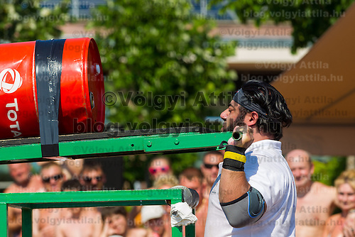 Patrik Baboumian Germany competes in viking press during the Giants Live Strongman Competition in Budapest, Hungary on June 17, 2012. ATTILA VOLGYI