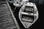 Monochrome image of rowboats at dock