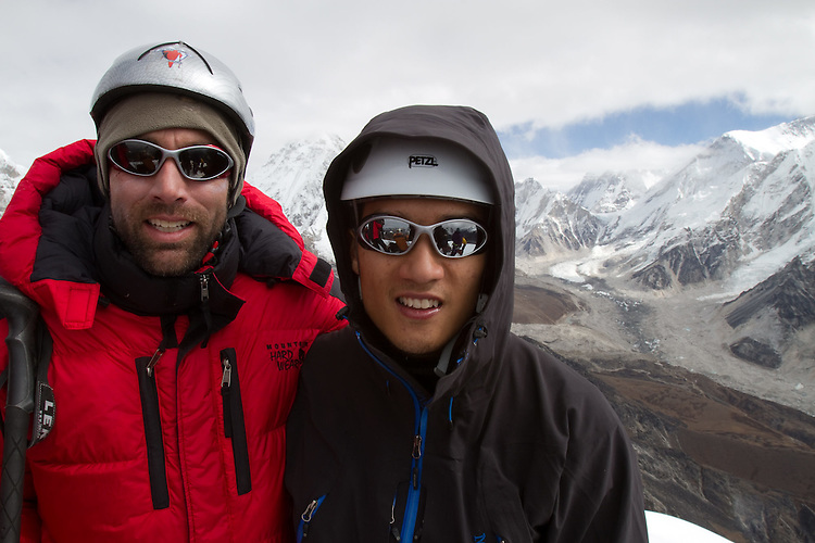 Blind climbers Erik Weihenmayer and Steve Baskis on top of Lobuche. Photo by Didrik Johnck.