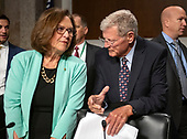 United States Senator Deb Fischer (Republican of Nebraska), left, and US Senator Jim Inhofe (Republican of Oklahoma), chairman, US Senate Committee on Armed Services, right, converse prior to hearing testimony before the committee from Ryan D. McCarthy on his nomination to be Secretary of the Army and Barbara M. Barrett on her nomination to be Secretary of the Air Force on Capitol Hill in Washington, DC on Thursday, September 12, 2019.<br /> Credit: Ron Sachs / CNP