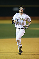 Johnny Aiello (2) of the Wake Forest Demon Deacons rounds the bases after hitting his second home run of the game against the Georgetown Hoyas at David F. Couch Ballpark on February 19, 2016 in Winston-Salem, North Carolina.  The Demon Deacons defeated the Hoyas 3-1.  (Brian Westerholt/Four Seam Images)