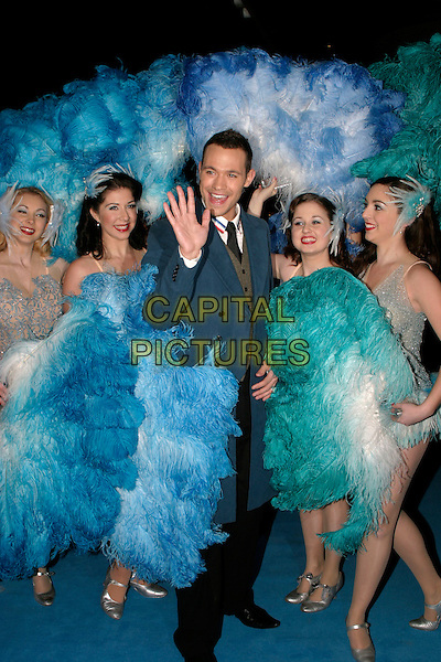 "WILL YOUNG.""Mrs. Henderson Presents"" - UK film premiere at Vue West End, London, UK..November 23rd, 2005.Ref: AH.full length feathers costume dress up hand waving gesture blue jacket.www.capitalpictures.com.sales@capitalpictures.com.© Capital Pictures."