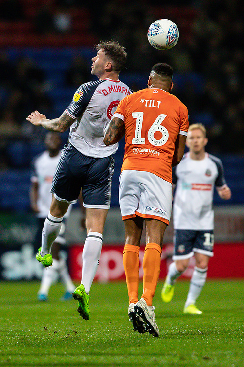 Bolton Wanderers' Daryl Murphy competing in the air with Blackpool's Curtis Tilt (right) <br /> <br /> Photographer Andrew Kearns/CameraSport<br /> <br /> The EFL Sky Bet League One - Bolton Wanderers v Blackpool - Monday 7th October 2019 - University of Bolton Stadium - Bolton<br /> <br /> World Copyright © 2019 CameraSport. All rights reserved. 43 Linden Ave. Countesthorpe. Leicester. England. LE8 5PG - Tel: +44 (0) 116 277 4147 - admin@camerasport.com - www.camerasport.com
