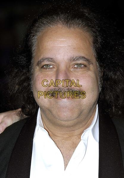 RON JEREMY.At The Premiere of Gumball 3000: The Movie, Odeon, Leicester Square.20/11/2003.headshot, portrait, mustache, facial hair, porn star, pornography.www.capitalpictures.com.sales@capitalpictures.com.©Capital Pictures