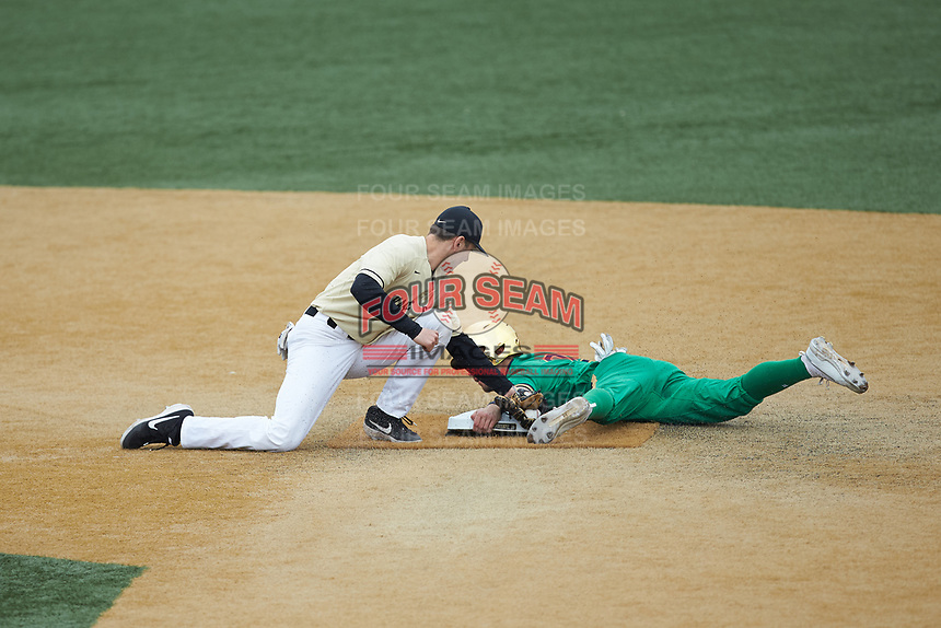 Spencer Myers (2) of the Notre Dame Fighting Irish holds on to second base as Michael Turconi (6) of the Wake Forest Demon Deacons applies a tag at David F. Couch Ballpark on March 10, 2019 in  Winston-Salem, North Carolina. The Demon Deacons defeated the Fighting Irish 7-4 in game one of a double-header.  (Brian Westerholt/Four Seam Images)