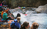 November 5, 2016 - Hendersonville, North Carolina.  A large crowd gathers for the action near the Scream Machine Rapids prior to the 21st annual Green Race.The Green River Narrows provides one of the most intense and extreme whitewater venues in the world and is home to many of the USA's most talented paddlers.  Green River Narrows, Hendersonville, North Carolina.