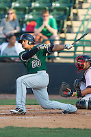 Geno Escalante (20) of the Augusta GreenJackets follows through on his swing against the Hickory Crawdads at L.P. Frans Stadium on May 11, 2014 in Hickory, North Carolina.  The GreenJackets defeated the Crawdads 9-4.  (Brian Westerholt/Four Seam Images)