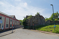"""Pictured: The derelict building in Bridge Street Tredegar where the stand-off took place.<br /> Re: The victim of a machete attack which led to an armed siege has been photographed showing his injuries.<br /> The man has been named locally as Nigel Davies, 57, who was assaulted with the weapon in the street two days ago.<br /> His attacker fled into a nearby derelict building where he spent 48 hours in a tense stand-off with armed police.<br /> But he was arrested early this morning(thurs) and is being questioned about a number of incidents.<br /> The graphic picture of Mr Davies was posted on social media after he was found covered in blood following the street attack in Tredegar, South Wales.<br /> He was treated in hospital for his facial wounds but is now at home with his family.<br /> An eye-witness at the scene of the siege said: """"The police are saying there is no danger to the public.<br /> """"But you can see from the picture that the victim was viciously assaulted with a weapon.""""<br /> Gwent Police confirmed that armed police were deployed after reports of a man armed with a machete was holed up inside the building on an industrial estate.<br /> Officers used riot shields to protect themselves when the man started throwing chunks of masonry at the them."""
