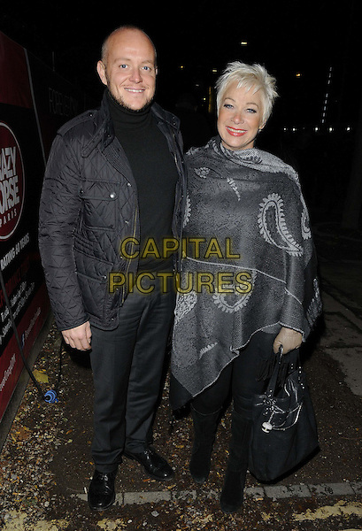 Lincoln Townley & Denise Welch.Crazy Horse Paris presents 'Forever Crazy' press night, South Bank, Upper Ground, London, England..1st November 2012.full length black  grey gray jacket trousers poncho couple boots bag purse .CAP/CAN.©Can Nguyen/Capital Pictures.