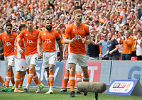 Blackpool's Brad Potts celebrating after scoring during the Sky Bet League 2 PLAY OFF FINAL match between Exeter City and Blackpool at Wembley Stadium, London, England on 28 May 2017. Photo by Andrew Aleksiejczuk.