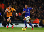 Youri Tielemans of Leicester City gets a head of Ruben Neves of Wolverhampton Wanderers during the Premier League match at Molineux, Wolverhampton. Picture date: 14th February 2020. Picture credit should read: Darren Staples/Sportimage