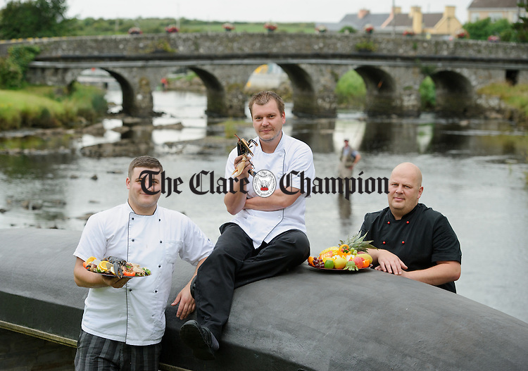 Chefs from Tubridy's; Przemyslaw Biesiekierski-Konkolewski, Petr Cadilek and Ryszard Stachon at the launch of the Doonbeg Seafood Festival which starts on Friday 25th July. Photograph by John Kelly.