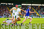 Brendan Brosnan Lixnaw in action against Sean Maunsell and Adrian Royle Kilmoyley in the County Senior Hurling final at Austin Stack Park on Saturday.