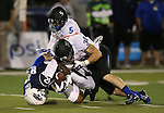 Boise State's Donte Deayon (5) and Corey Bell (38) bring down Nevada receiver Hasaan Henderson (12) during the first half of an NCAA college football game in Reno, Nev., on Saturday, Oct. 4, 2014. Boise State won 51-46. (AP Photo/Cathleen Allison)