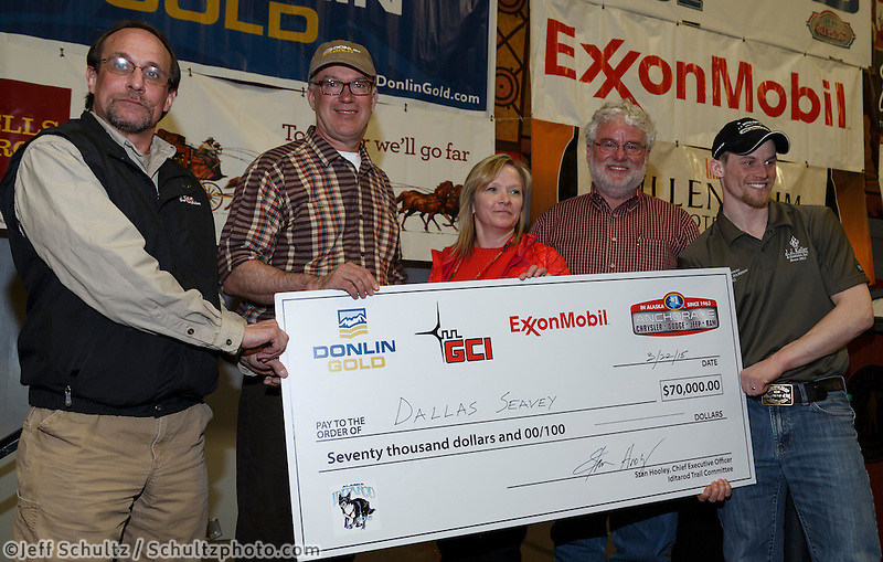 The four major Iditarod sponsors award the $70,000 winner check to 2015 Iditarod champion Dallas Seavey at the finishers banquet in Nome on Sunday  March 22, 2015 during Iditarod 2015.  <br /> <br /> (C) Jeff Schultz/SchultzPhoto.com - ALL RIGHTS RESERVED<br />  DUPLICATION  PROHIBITED  WITHOUT  PERMISSION