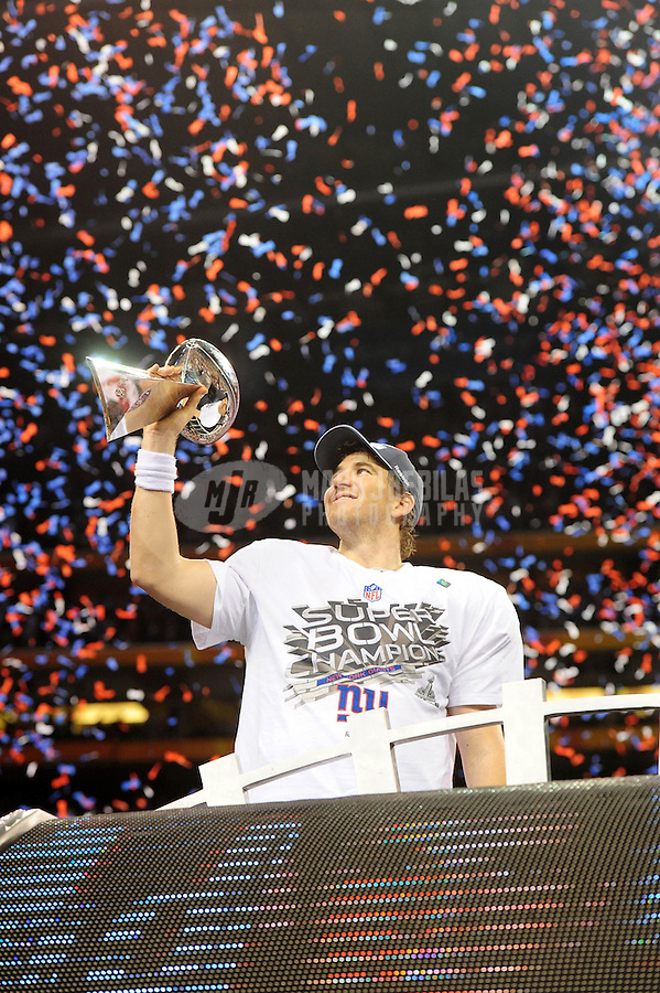 Feb 5, 2012; Indianapolis, IN, USA; New York Giants quarterback Eli Manning holds the Vince Lombardi trophy after the Giants defeated the New England Patriots 21-17 in Super Bowl XLVI at Lucas Oil Stadium.  Mandatory Credit: Mark J. Rebilas-...