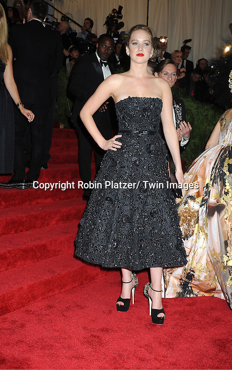Jennifer Lawrence  attends  the Metropolitan Museum of Art Costume Institute Beneift celebrating the opening of  PUNK: Chaos .to Couture on May 6, 2013 in New York City.