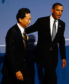 Pittsburgh, PA - September 24, 2009 -- United States President Barack Obama (R) escorts Japanese Prime Minister Yukio Hatoyama while welcoming him to the opening dinner for G-20 leaders at the Phipps Conservatory on Thursday, September 24, 2009 in Pittsburgh, Pennsylvania. Heads of state from the world's leading economic powers arrived today for the two-day G-20 summit held at the David L. Lawrence Convention Center aimed at promoting economic growth. .Credit: Win McNamee / Pool via CNP