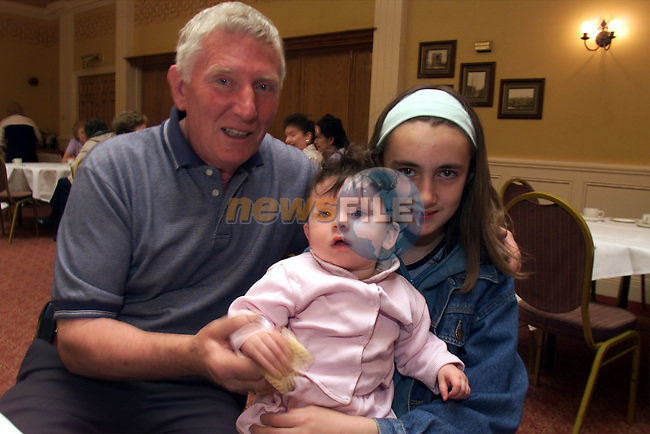 Christy Donnelly and his granddaughters Alice and Tara-Jane Donnelly the Drogheada Senior Citizens Club coffee morning in the Westcourt Hotel..Picture:Arthur Carron