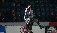 Paul Hayes of Wycombe Wanderers celebrates with goal scorer Michael Harriman of Wycombe Wanderers during the Sky Bet League 2 match between Wycombe Wanderers and Notts County at Adams Park, High Wycombe, England on 15 December 2015. Photo by Andy Rowland.