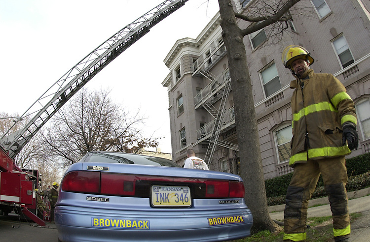 RC20000301-009-IW: March 1, 2000: A fire destroyed much of no. 1 3rd St., NE on Capitol Hill, where two senators lived, including Kansas Sen. Sam Brownback. The location was two blocks from the Capitol and near the rear of the Library of Congress.  Pictured is fireman Michael Smith.      Ian Wagreich/Roll Call