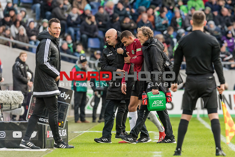 09.02.2019, HDI Arena, Hannover, GER, 1.FBL, Hannover 96 vs 1. FC Nuernberg<br /> <br /> DFL REGULATIONS PROHIBIT ANY USE OF PHOTOGRAPHS AS IMAGE SEQUENCES AND/OR QUASI-VIDEO.<br /> <br /> im Bild / picture shows<br /> Kevin Akpoguma (Neuzugang Hannover 96 #14) verl&auml;sst verletzungsbedingt Spielfeld gest&uuml;tzt von Prof. Dr. Axel Partenheimer und Ralf Blume (Chef Physiotherapeut Hannover 96), Verletzung rechte Schulter,<br /> <br /> Foto &copy; nordphoto / Ewert
