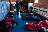 The top mushers take a nap inside the community center during their 8 hour layover at the village checkpoint  of Ruby during the 2010 Iditarod