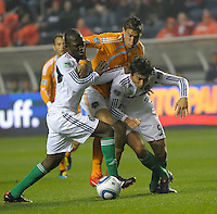Houston midfielder Geoff Cameron (20) battles with Chicago midfielders Patrick Nyarko (14) and Baggio Husidic (9).  The Chicago Fire defeated the Houston Dynamo 2-0 at Toyota Park in Bridgeview, IL on April 24, 2010.