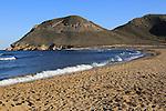 Beach and waves at Playa de Playazo, Rodalquilar, Cabo de Gata natural park, Almeria, Spain