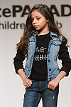 Model walks runway in an outfit  from the DL1961 collection during the petitePARADE fashion show at Children's Club in the Jacob Javits Center in New York City on February 25, 2018.