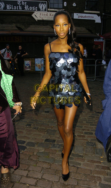 JAMELIA.Attends the 11th Annual MOBO Awards Nominations & Launch at Proud Camden, London, England, .August 15th 2006..full length blue and grey black circles discs retro mini dress legs shoes ponytail hair up purse clutch bag.Ref: CAN.www.capitalpictures.com.sales@capitalpictures.com.©Can Nguyen/Capital Pictures