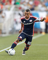 New England Revolution substitute forward Fernando Cardenas (80) dribbles down the wing. In a Major League Soccer (MLS) match, Toronto FC defeated New England Revolution, 1-0, at Gillette Stadium on July 14, 2012.