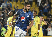 BOGOTA - COLOMBIA, 03-02-2019: Matias De Los Santos de Millonarios celebra después de anotar el segundo gol de su equipo durante partido por la fecha 3 de la Liga Águila I 2019 entre Millonarios y Atlético Bucaramanga jugado en el estadio Nemesio Camacho El Campin de la ciudad de Bogotá. / Matias De Los Santos (L) of Millonarios celebrates after scoring the second goal of his team during match for the date 3 of the Liga Aguila I 2019 between Millonarios and Atletico Bucaramanga played at the Nemesio Camacho El Campin Stadium in Bogota city. Photo: VizzorImage / Gabriel Aponte / Staff.