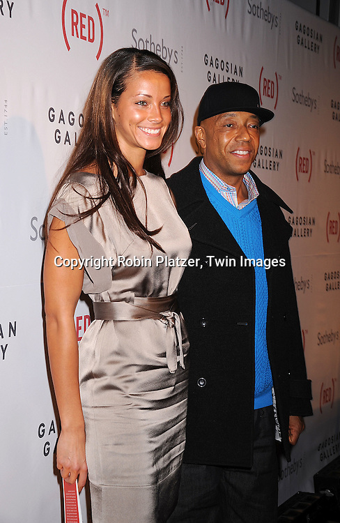 Russell Simmons and girlfriend Porschla Coleman.at The (RED) Auction at Sotheby's on February 14, 2008 in New York City. The event is designed to raise money for the treatment of HIV/AIDS in Africa. .Robin Platzer, Twin Images..212-935-0770