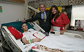 United States President George W. Bush stands with Pvt. 1st. Class Arturo E. Weber and his cousin, Lisa, after awarding the Marine with a Purple Heart during a visit Friday, May 25, 2007, to the National Naval Medical Center in Bethesda, Md., where he is recovering from wounds received in Operation Iraqi Freedom.  <br /> Mandatory Credit: Joyce Boghosian - White House via CNP