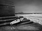 Surfer, about to risk the cold polluted waters of Aberavon Beach, Port Talbot, South Wales, U.K.