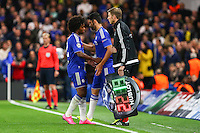 Willian of Chelsea is substituted for Diego Costa of Chelsea (right) after opening the scoring for Chelsea during the UEFA Champions League match between Chelsea and Maccabi Tel Aviv at Stamford Bridge, London, England on 16 September 2015. Photo by David Horn.