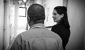 "Physician assistant Jen Vaupel chats with  Robert ""Bobby"" Young's  before a check up at Bread for the City in Washington, DC."