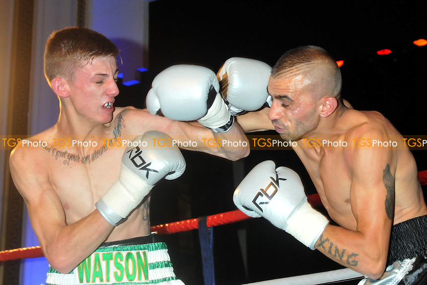 Brad Watson (white shorts) defeats Stefan Slavchev in a Super-Flyweight boxing contest at the Camden Centre, promoted by Mickey Hellliet - 27/09/13 - MANDATORY CREDIT: Philip Sharkey/TGSPHOTO - Self billing applies where appropriate - 0845 094 6026 - contact@tgsphoto.co.uk - NO UNPAID USE