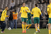 MELBOURNE, 11 JUNE 2013 - Mark MILLIGAN of Australia warms up for a Round 4 FIFA 2014 World Cup qualifier match between Australia and Jordan at Etihad Stadium, Melbourne, Australia. Photo Sydney Low for Zumapress Inc. Please visit zumapress.com for editorial licensing. *This image is NOT FOR SALE via this web site.