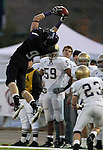 ROME, GA - DECEMBER 18: Alex Anderson #9 of the University of Sioux Falls reaches high to bring in a catch in front of Mike Waldenberg #23 of Carroll College in the second quarter at Barron Stadium in the 2010 NAIA National Football Championship in Rome, GA.(photo by Dave Eggen/Inertia)