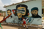 school with mural politics billboards about Castro and El Che