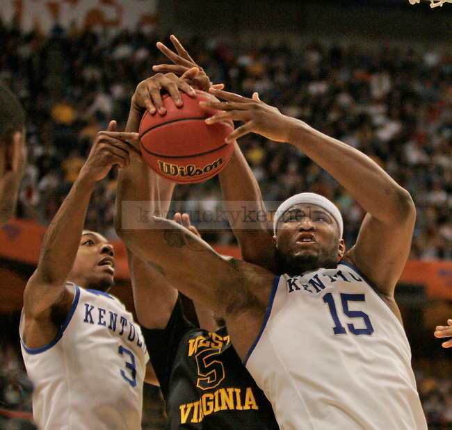 UK's DeMarcus Cousins battles for a rebound against West Virginia at the Carrier Dome on Saturday, March 27, 2010. Photo by Scott Hannigan | Staff