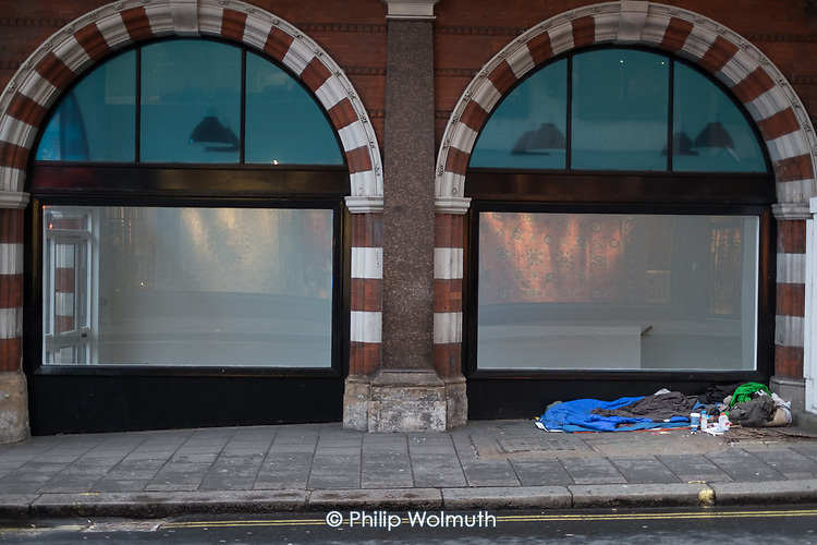 Sleeping place and belongings of homeless rough sleeper, Mayfair, London