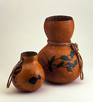 A traditional Hawaiian hula implement (ipu and ipuheke) made from gourds.