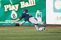 Right fielder Johnny Drennen (22) of the Kinston Indians dives for a ball at Ernie Shore Field in Winston-Salem, NC, Saturday, May 17, 2008.