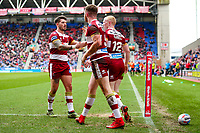 Picture by Alex Whitehead/SWpix.com - 11/03/2018 - Rugby League - Betfred Super League - Wigan Warriors v Wakefield Trinity - DW Stadium, Wigan, England - Wigan's Joe Burgess celebrates his try with Oliver Gildart (L) and Liam Farrell (R).