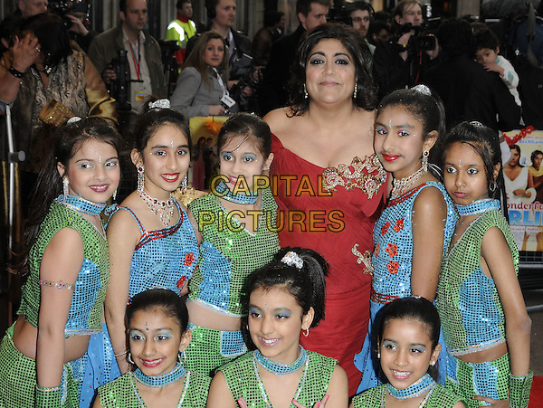 "GURINDER CHADHA & DANCERS.The ""It's A Wonderful Afterlife"" UK premiere, Odeon West End, Leicester Square, London, England. .April 12th, 2010.half length atmosphere green blue sequins sequined costume sari trousers jacket top sleeveless posing red off the shoulder dress.CAP/CAN.©Can Nguyen/Capital Pictures."
