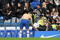 Chelsea's Olivier Giroud hands over his shirt at the end of the match to some Chelsea fans during Chelsea vs Everton, Premier League Football at Stamford Bridge on 8th March 2020